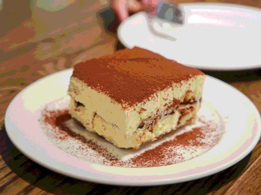 Slab of tiramisu on plate restaurant illustrated recipe italian